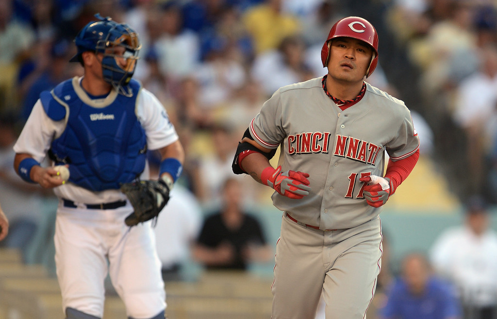 . The Reds\' Shin-Soo Choo #17 heads for 1st base after Dodger pitcher Hyun-Jin Ryu #99 walked him in the 1st inning during their game at Dodger Stadium in Los Angeles Saturday, July 27, 2013. (Hans Gutknecht/Los Angeles Daily News)