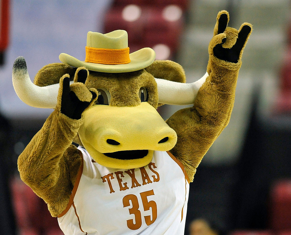 . The Texas mascot dances during a timeout in the second half of game against Penn in the first round of the NCAA women\'s college basketball tournament on Sunday, March 23, 2014, in College Park, Md. Texas won 79-61. (AP Photo/Gail Burton)