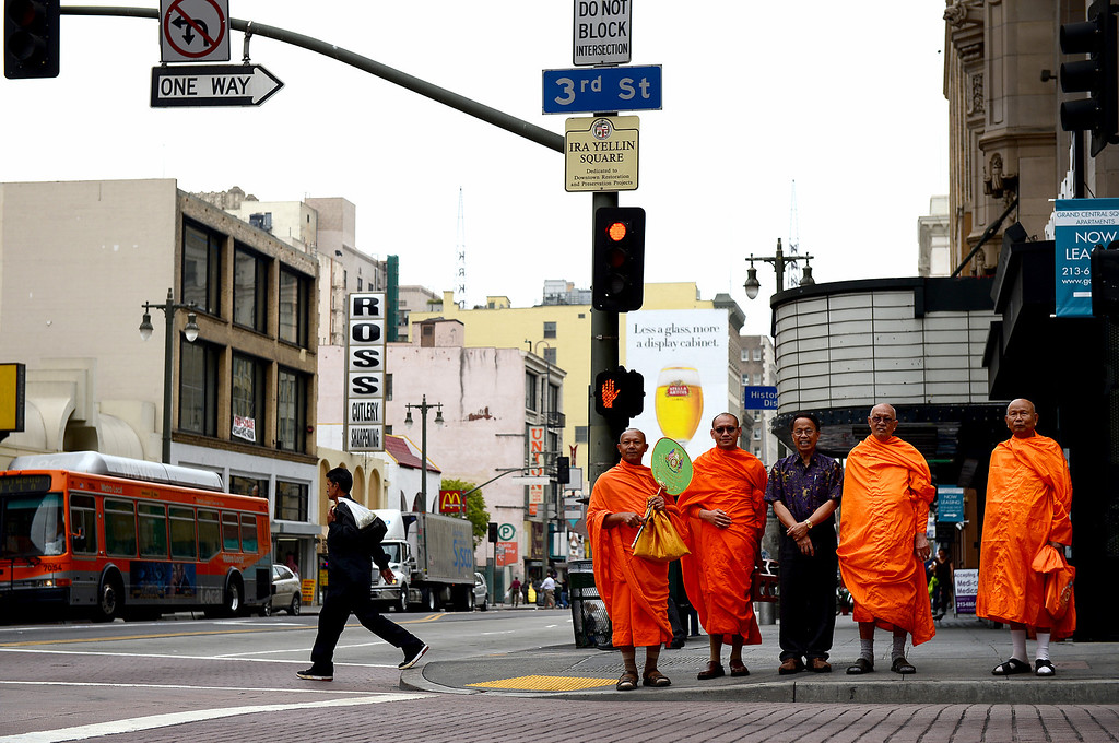 . Wat Thai Temple monks, of North Hollywood, leave the Grand Central Market in downtown Los Angeles Monday, April 30, 2013 after blessing the market\'s new restaurant Sticky Rice. Sticky Rice, owned by David Tewasart, of Pasadena, is kicking off the openings of new restaurants at the market. (SGVN/Staff Photo by Sarah Reingewirtz)
