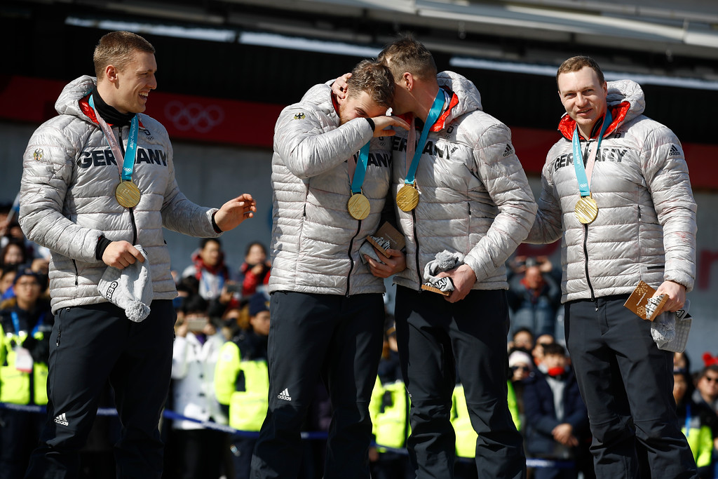. Gold Medalists driver Francesco Friedrich, Candy Bauer, Martin Grothkopp and Thorsten Margis of Germany celebrate during the medals ceremony after winning the four-man bobsled competition final at the 2018 Winter Olympics in Pyeongchang, South Korea, Sunday, Feb. 25, 2018. (AP Photo/Patrick Semansky)