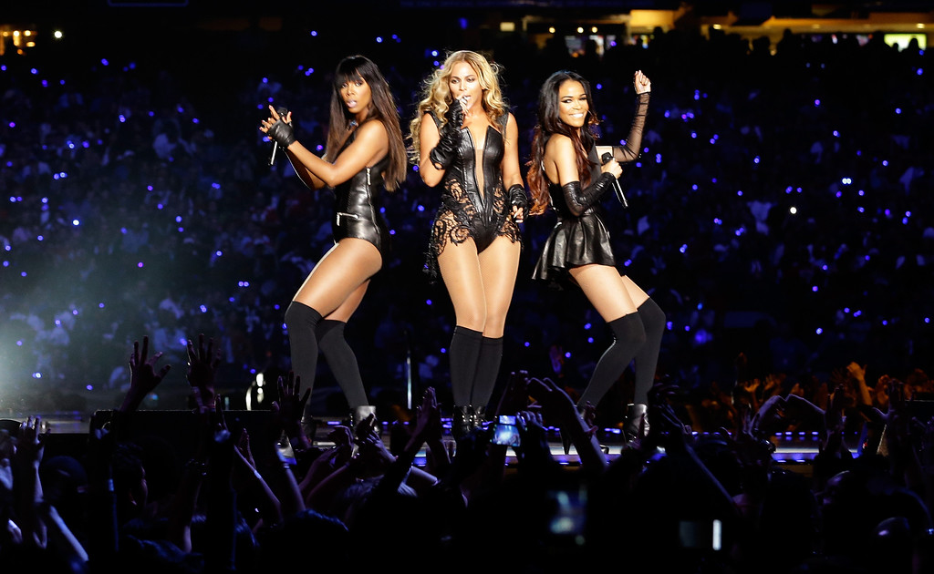 . Singers Kelly Rowland, Beyonce and Michelle Williams perform during the Pepsi Super Bowl XLVII Halftime Show at the Mercedes-Benz Superdome on February 3, 2013 in New Orleans, Louisiana.  (Photo by Ezra Shaw/Getty Images)