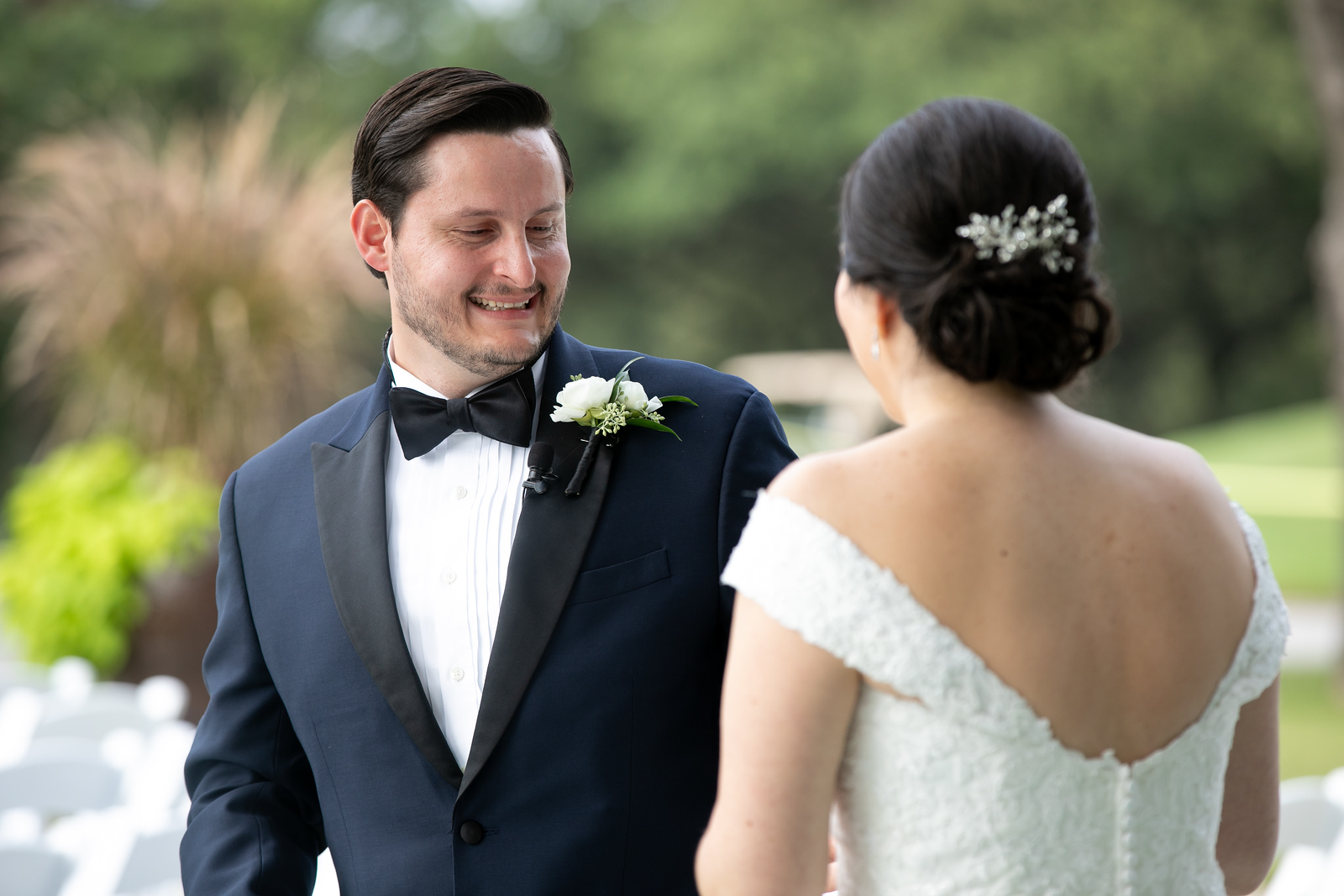 groom smiling as he sees his fiance for the first time at their first look