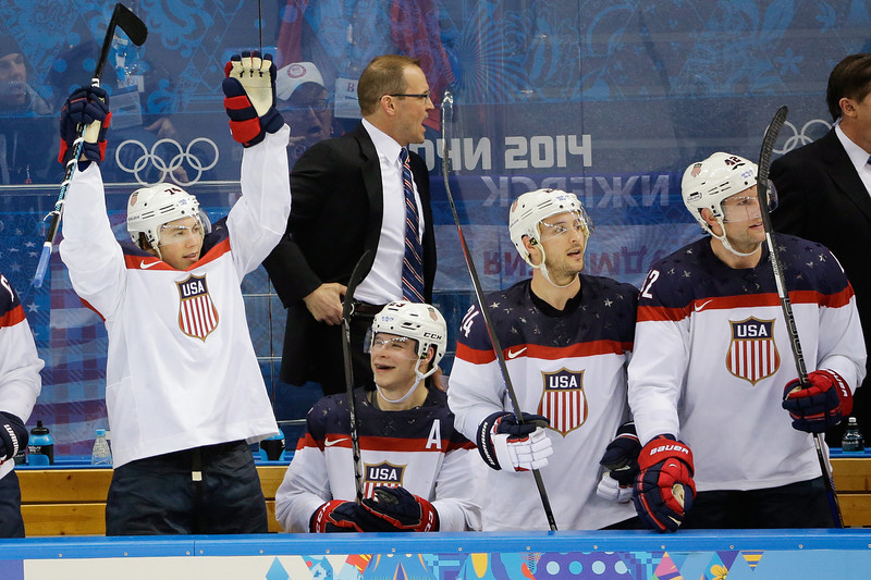 . Team USA player reacts from the bench after a goal by forward Phil Kessel during the third period of men\'s quarterfinal hockey game against the Czech Republic in Shayba Arena at the 2014 Winter Olympics, Wednesday, Feb. 19, 2014, in Sochi, Russia. (AP Photo/David J. Phillip )