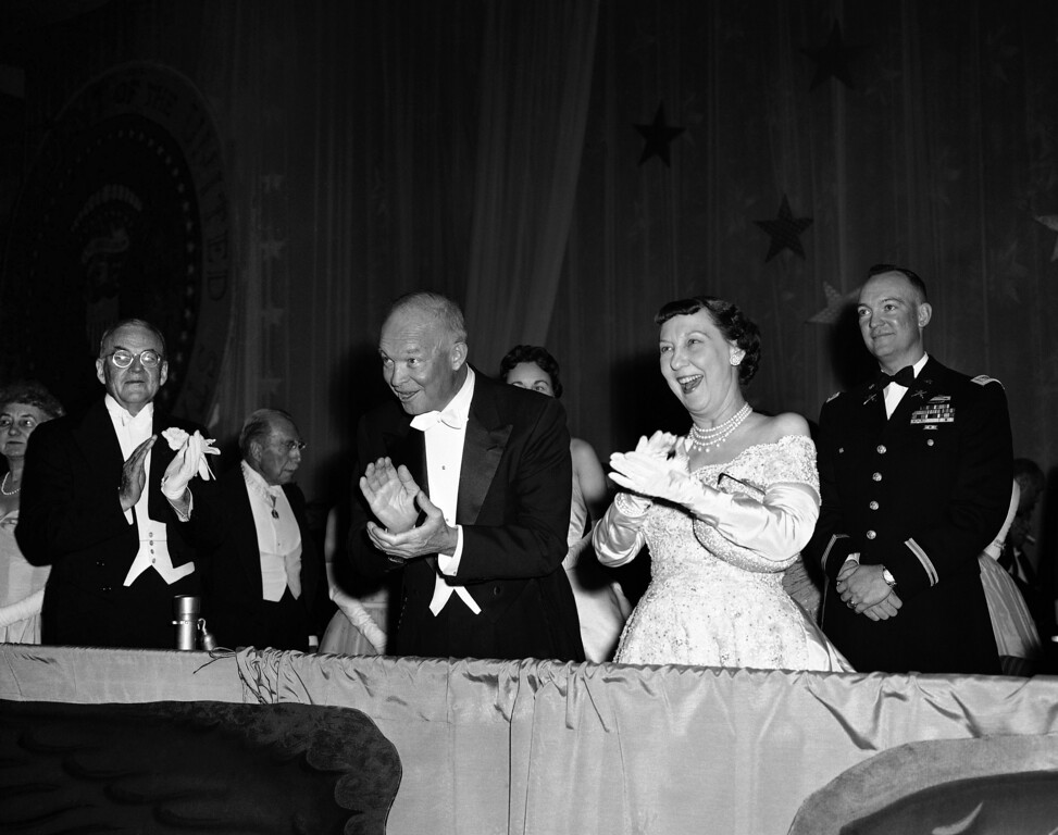 . President Dwight Eisenhower and Mrs. Mamie Eisenhower applaud entertainment at the Mayflower Hotel in Washington on Jan. 21, 1957, their third stop on round of inaugural balls held in the city. Balls culminated a momentous day for Ike and Mamie. (AP Photo)