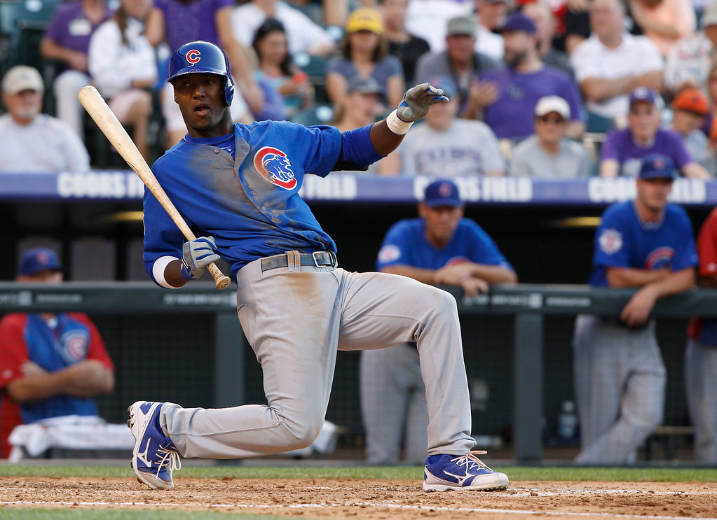 . Chicago Cubs\' Junior Lake falls out of the batter\'s box to avoid an inside pitch against the Colorado Rockies in the fourth inning of a baseball game in Denver on Saturday, July 20, 2013, in Denver. (AP Photo/David Zalubowski)
