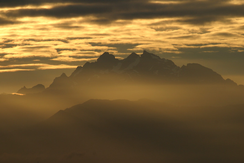 The Olympic Mountains stand in relief to a winter sunset