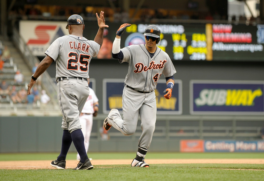 . Detroit Tigers� Victor Martinez, right and Dave Clark, left, during a baseball game in Minneapolis, Sunday, Aug. 24, 2014. (AP Photo/Tom Olmscheid)