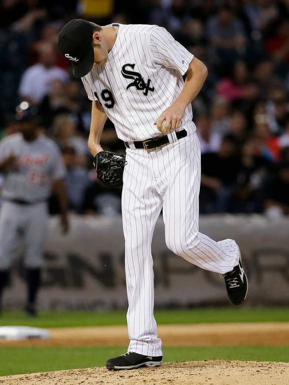 . Chicago White Sox starter Chris Sale kicks the dirt after Detroit Tigers\' Victor Martinez hit a solo home run during the fifth inning of a baseball game in Chicago on Thursday, June 12, 2014. (AP Photo/Nam Y. Huh)