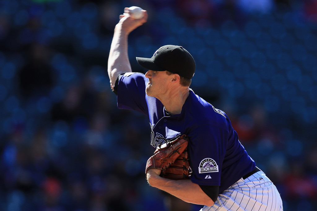 . Matt Belisle #34 of the Colorado Rockies delivers against the Atlanta Braves at Coors Field on April 24, 2013 in Denver, Colorado. Matt Belisle earned the win as the Rockies defeated the Braves 6-5 in 12 innings.  (Photo by Doug Pensinger/Getty Images)