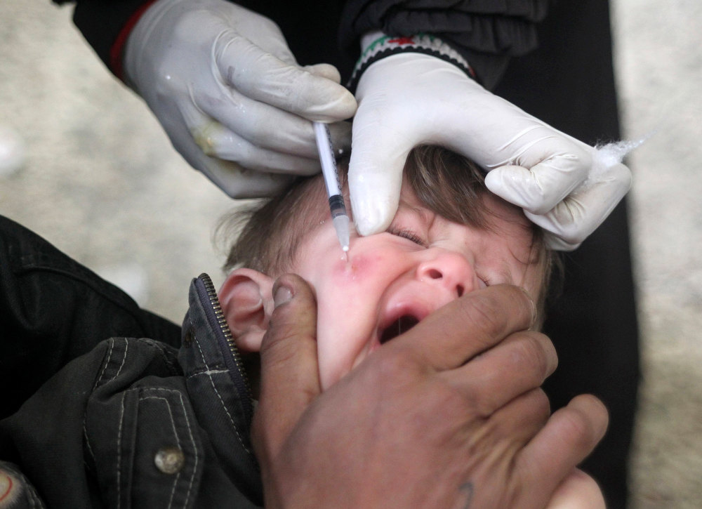 Description of . A doctor collects blood from a child showing symptoms of leishmaniasis for a blood test at a hospital in Aleppo, February 11, 2013. Doctors in Aleppo and Deir al-Zor have reported outbreaks of leishmaniasis, an endemic tropical disease transmitted by sand-flies that causes skin ulcers resembling leprosy, the World Health Organization (WHO) said. Poor waste management and lack of hygiene have fuelled its spread, but the U.N. agency is trying to deliver medicines to both hotspots, WHO spokesman Glenn Thomas told a news briefing. REUTERS/Muzaffar Salman