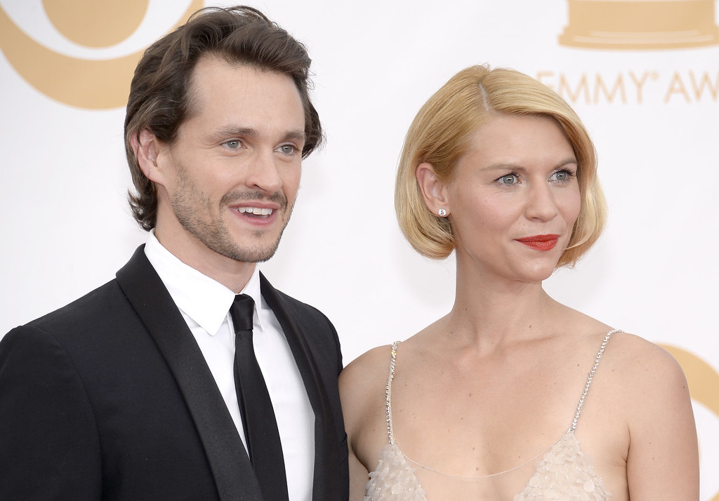 . Actors Hugh Dancy and Claire Danes arrives at the 65th Annual Primetime Emmy Awards held at Nokia Theatre L.A. Live on September 22, 2013 in Los Angeles, California.  (Photo by Kevork Djansezian/Getty Images)
