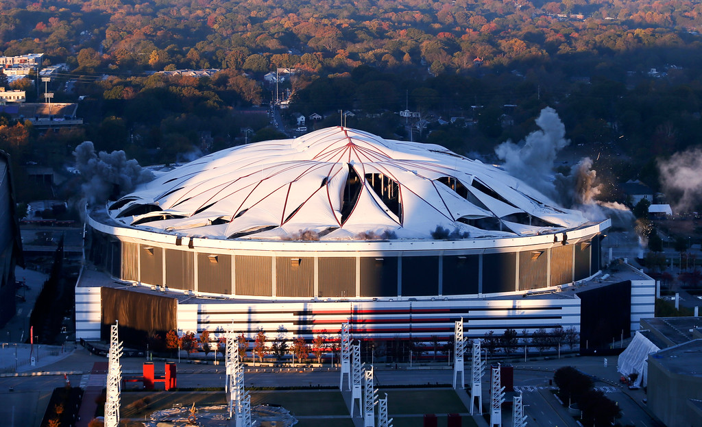 . The Georgia Dome is destroyed in a scheduled implosion Monday, Nov. 20, 2017, in Atlanta. The Dome was the home of the Atlanta Falcons, hosted two Super Bowls and the 1996 Summer Olympic Games among other sporting events. (AP Photo/John Bazemore)