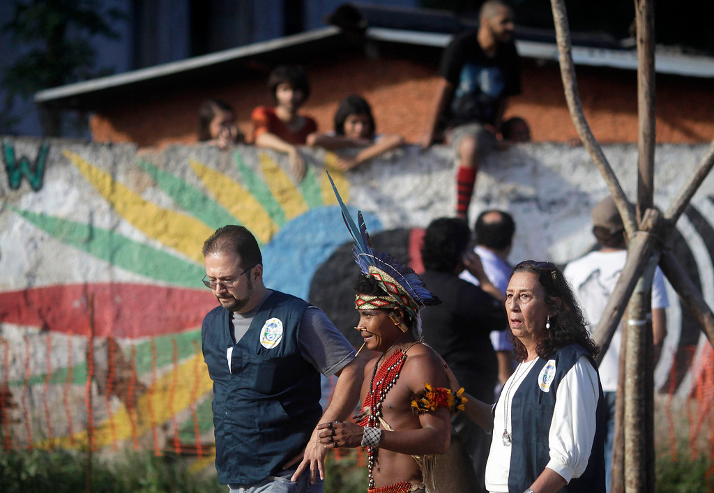 . A Native Indian leaves the Brazilian Indian Museum after a deal with the authorities in Rio de Janeiro March 22, 2013. Brazilian military police took position early morning outside the Indian museum, where a native Indian community of around 30 individuals who have been living in the abandoned Indian Museum since 2006. Indians were summoned to leave the museum in 72 hours by court officials since last week, local media reported. The group is fighting against the destruction of the museum, which is next to the Maracana Stadium. Some Indians left, but several are still resisting. REUTERS/Ricardo Moraes