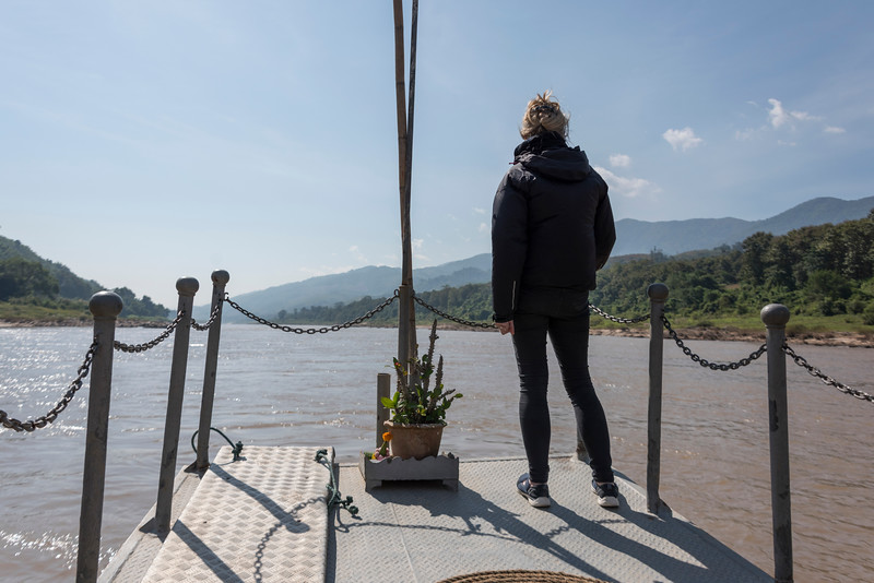Rear view of woman standing on dock, River Mekong, Laos