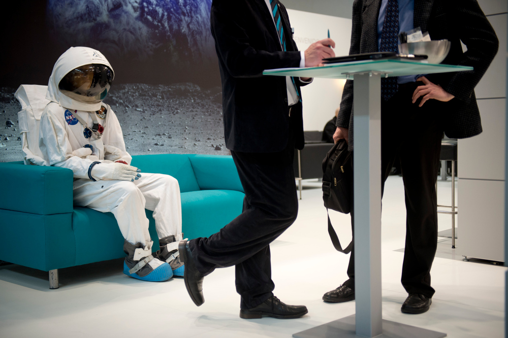 . An astronaut is seen sitting on the couch behind two business men at the Wittenstein booth at the Hanover industrial fair on April 8, 2013 in Hanover, central Germany. The fair running from April 8 to 12, 2013 will present a cross section of key industrial technologies.  ODD ANDERSEN/AFP/Getty Images
