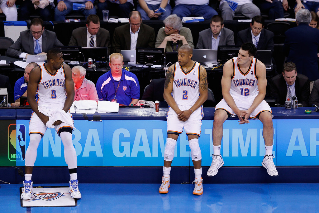 . OKLAHOMA CITY, OK - MAY 27: Serge Ibaka #9, Caron Butler #2 and Steven Adams #12 of the Oklahoma City Thunder wait at the scorer\'s table in the second half against the San Antonio Spurs during Game Four of the Western Conference Finals of the 2014 NBA Playoffs at Chesapeake Energy Arena on May 27, 2014 in Oklahoma City, Oklahoma. (Photo by Joe Robbins/Getty Images)
