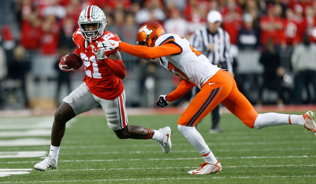 . Ohio State receiver Parris Campbell tries to escape the grasp of Illinois defensive back Ahmari Hayes during the first half of an NCAA college football game Saturday, Nov. 18, 2017, in Columbus, Ohio. (AP Photo/Jay LaPrete)