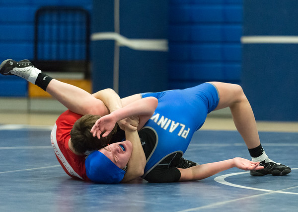 01/23/19 Wesley Bunnell | Staff Plainville wrestling defeated Berlin at home on Wednesday night. Plainville's Dakota Dinielli vs Berlin Dan Veleas in the 145lb match.