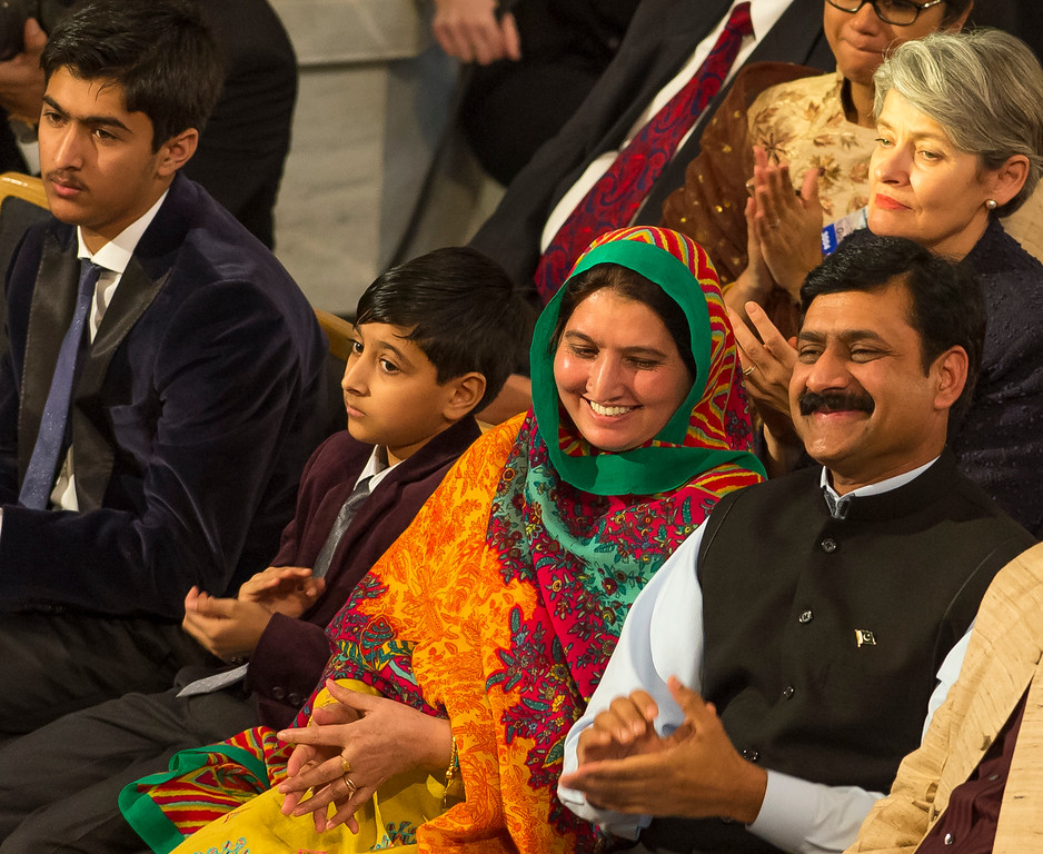 . OSLO, NORWAY - DECEMBER 10: Khushal Khan Yousafzai, Apal Khan Yousafzai, Toorpekai Yousafzai and Ziauddin Yousafzai watch as Malala Yousafzai delivers her acceptance speech a the Nobel Peace Prize Ceremony at Oslo City Hall  on December 10, 2014 in Oslo, Norway. (Photo by Nigel Waldron/Getty Images)