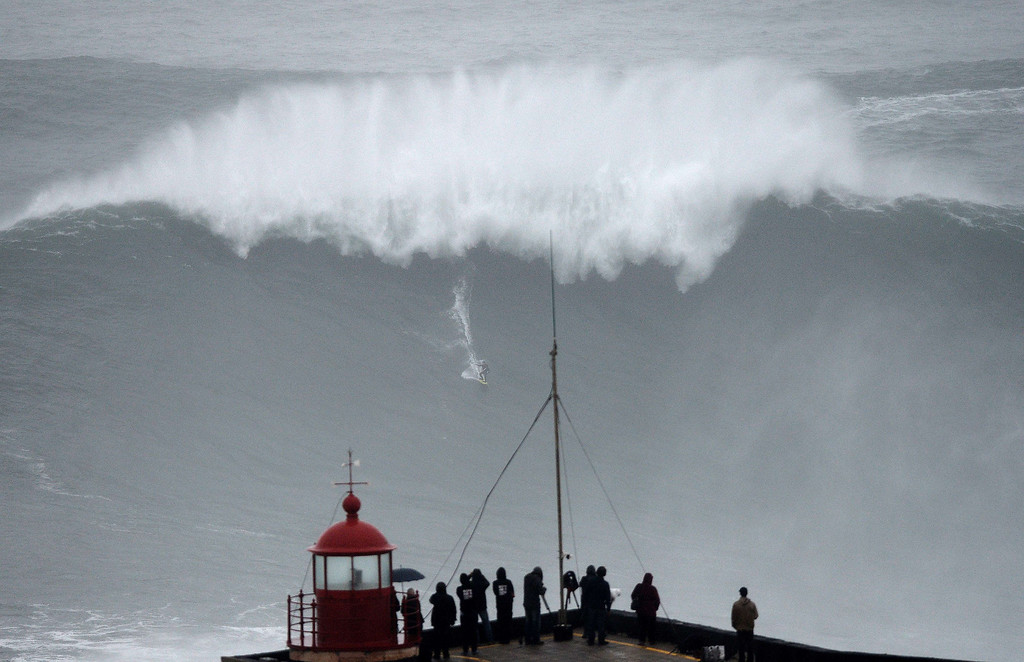 . Brazilian big wave surfer Carlos Burle rides a wave in Nazare, central Portugal, on October 28, 2013.   FRANCISCO LEONG/AFP/Getty Images