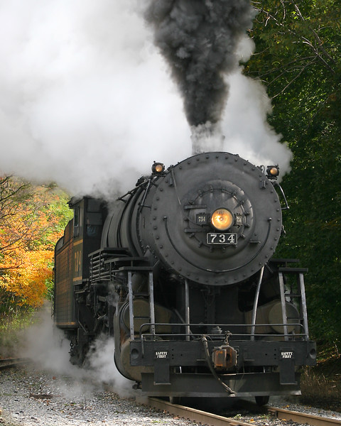 #734 steam train approaching Frostburg in the late September foliage Western Maryland Scenic Railroad