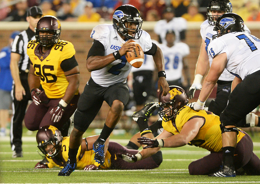. Eastern Illinois quarterback Jalen Whitow scrambles out of the pocket after he is pressured by the Gophers defense in the fourth quarter. (Pioneer Press: John Autey)