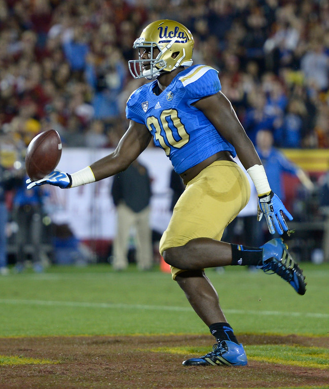 . UCLA Myles Jack scores a TD in the first quarter. UCLA and USC played in a matchup of cross town rivals at the Los Angeles Memorial Coliseum in Los Angeles, CA.  photo by (John McCoy/Los Angeles Daily News)
