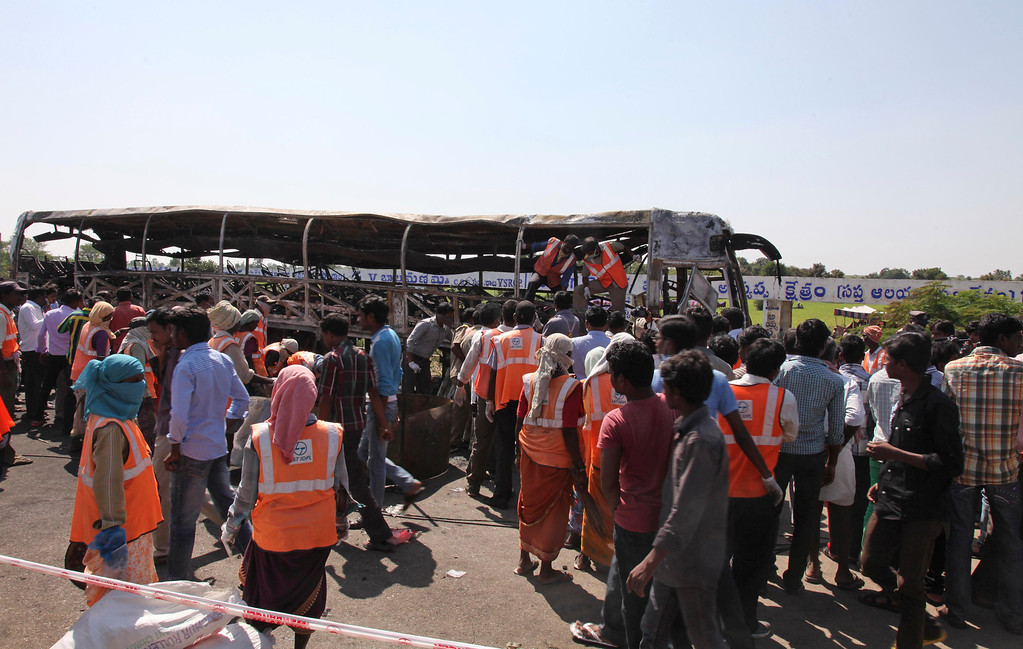 . Rescuers and others gather at the site of a bus accident at Mehabubnagar, in the southern Indian state of Andhra Pradesh, Wednesday, Oct. 30, 2013.  (AP Photo/Mahesh Kumar A.)