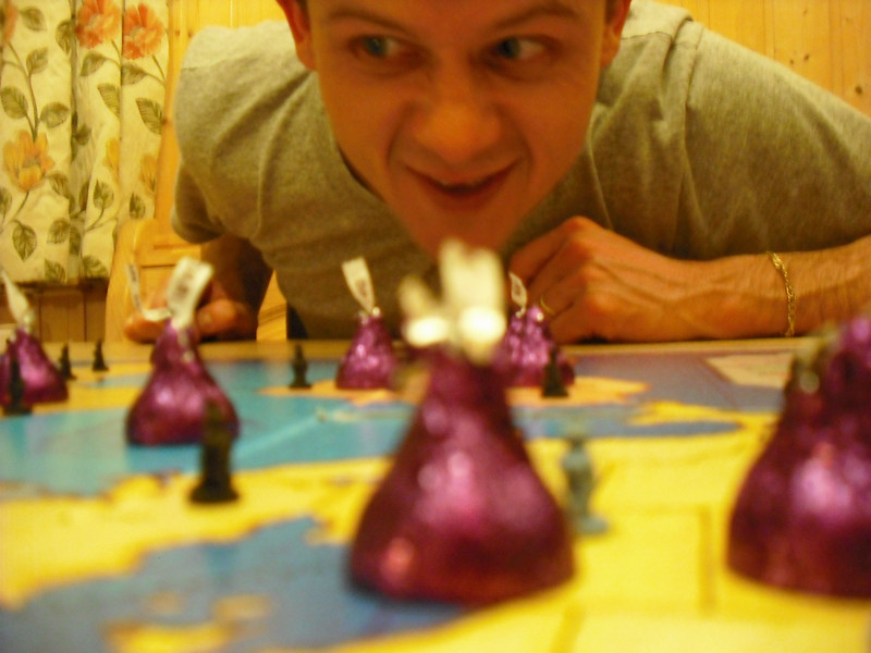"""At night, in good ski-trip fashion, we partied, ate too much, drank too much. I also tricked everyone into playing my all time favorite board game: Risk. Here I am after """"global domination"""".  I don't remember why there were Hershey kisses on the game board."""
