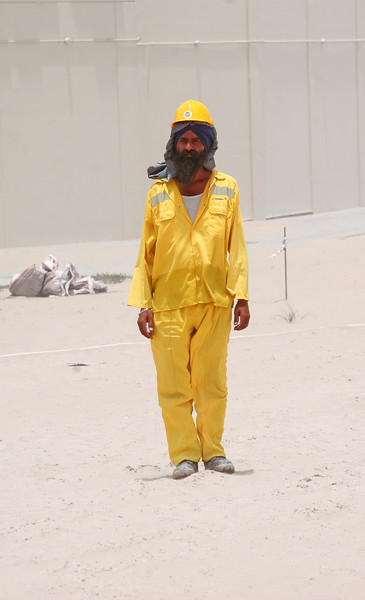 A Pakistani construction worker roasting in the heat for $200 US a month.