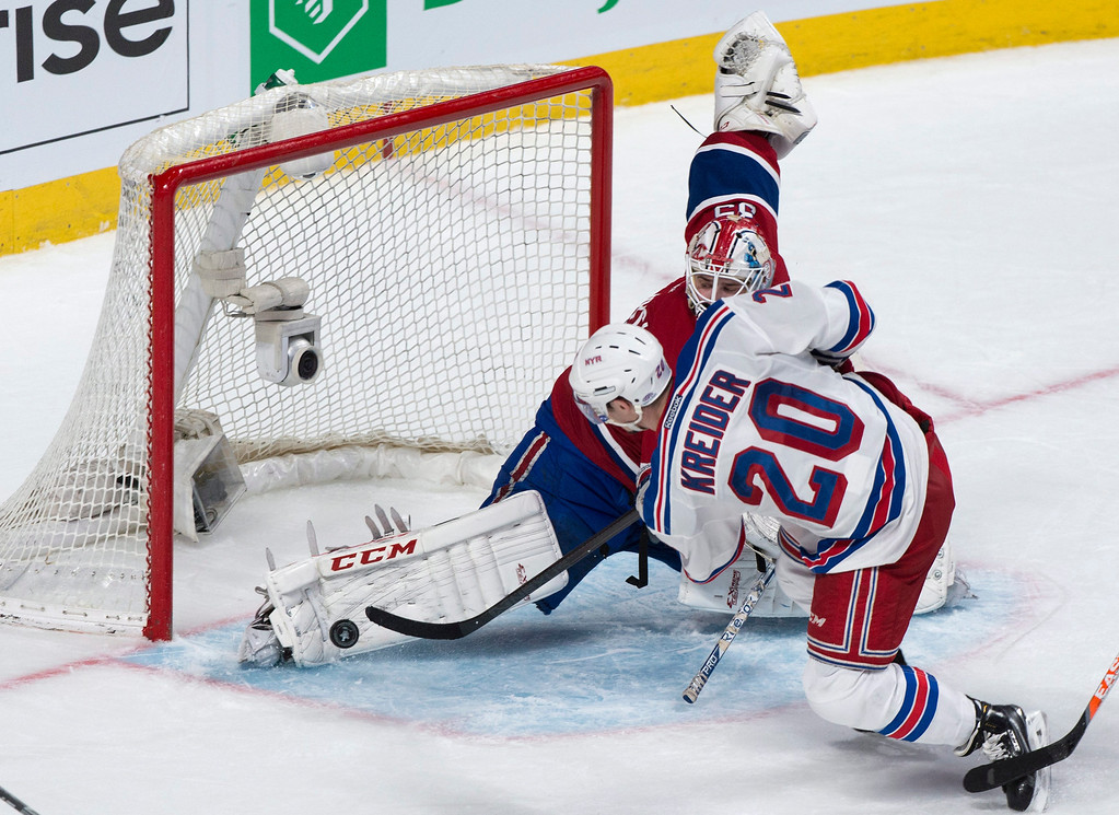 . Montreal Canadiens goalie Dustin Tokarski makes a kick save off New York Rangers\' Chris Kreider  during the third period of Game 5 of the NHL hockey Stanley Cup playoffs Eastern Conference finals, Tuesday, May 27, 2014, in Montreal. Montreal won 7-4. (AP Photo/The Canadian Press, Paul Chiasson)