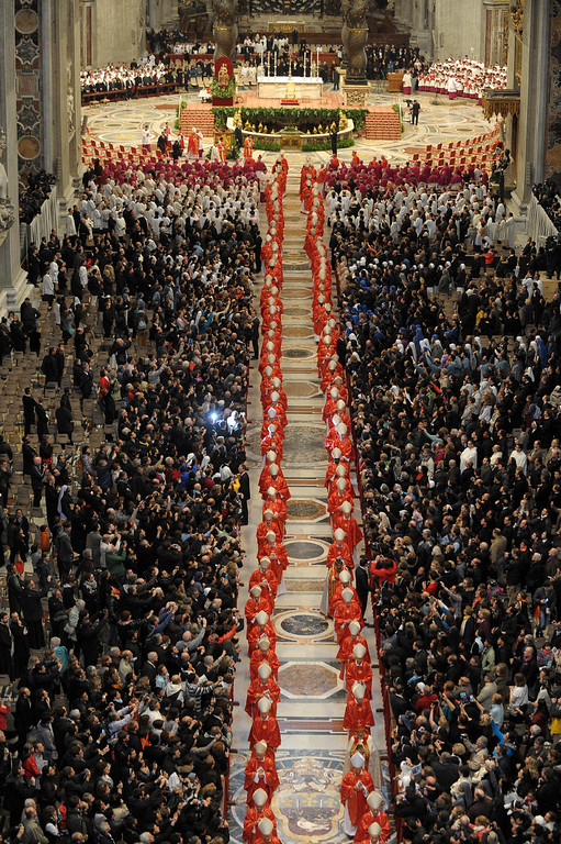 . In this photo provided by the Vatican newspaper L\'Osservatore Romano, cardinals, in red, and faithful attend a Mass for the election of a new pope celebrated by Cardinal Angelo Sodano inside St. Peter\'s Basilica, at the Vatican, Tuesday, March 12, 2013. Cardinals enter the Sistine Chapel on Tuesday to elect the next pope amid more upheaval and uncertainty than the Catholic Church has seen in decades. (AP Photo/L\'Osservatore Romano, ho)