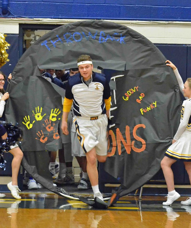 . Paul DiCicco - The News-Herald Wickliffe Lucas Thomeier breaks through the banner before a home game against Orange Jan 3.