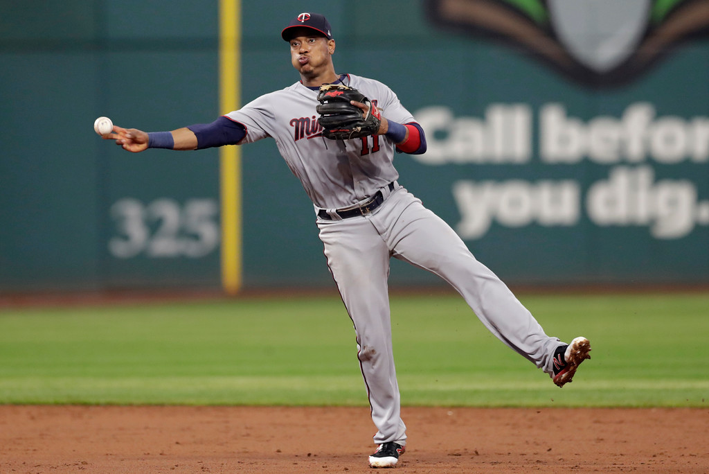 . Minnesota Twins\' Jorge Polanco throws out Cleveland Indians\' Rajai Davis at first base during the fifth inning of a baseball game Tuesday, Aug. 7, 2018, in Cleveland. (AP Photo/Tony Dejak)