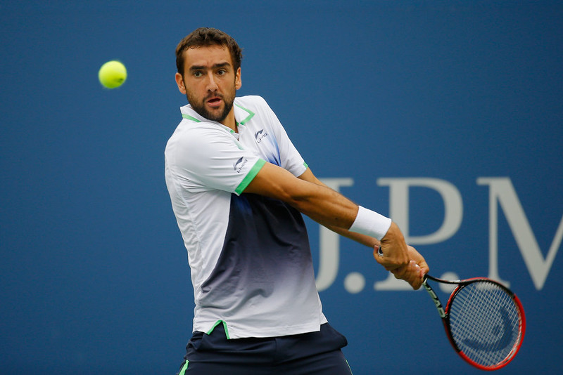 . Marin Cilic of Croatia returns a shot against Kei Nishikori of Japan during the men\'s singles final match on Day Fifteen of the 2014 US Open at the USTA Billie Jean King National Tennis Center on September 8, 2014 in the Flushing neighborhood of the Queens borough of New York City.  (Photo by Chris Trotman/Getty Images for USTA)
