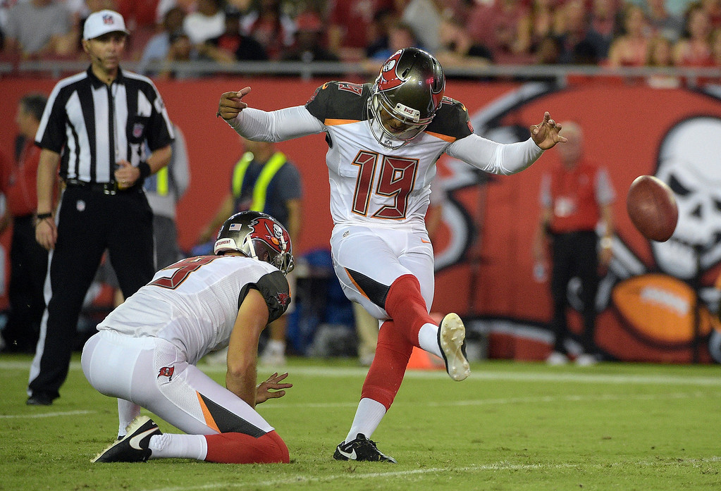 . Tampa Bay Buccaneers kicker Roberto Aguayo (19) kicks a field goal against the Cleveland Browns during the second half of an NFL preseason football game Friday, Aug. 26, 2016, in Tampa, Fla. Holding is Bryan Anger (9). (AP Photo/Phelan M. Ebenhack)