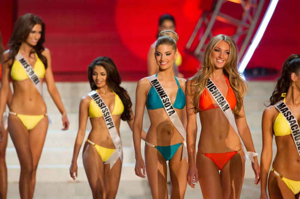 . In this photo provided by the Miss Universe Organization,  Miss Michigan USA 2013, Jaclyn Schultz; Miss Minnesota USA 2013, Danielle Hooper; Miss Mississippi USA 2013, Paromita Mitra; and Miss Missouri USA 2013, Ellie Holtman; compete in their swimsuits during the  2013 Miss USA Competition Preliminary Show in Las Vegas on Wednesday June 12, 2013.   She will compete for the title of Miss USA 2013 and the coveted Miss USA Diamond Nexus Crown on June 16, 2013.  (AP Photo/Miss Universe Organization, Darren Decker)