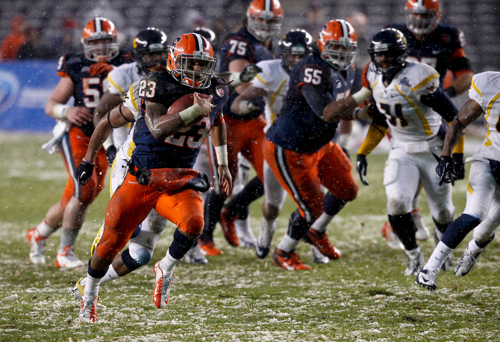 Description of . Prince-Tyson Gulley #23 of the Syracuse Orange runs in for touchdown against the West Virginia Mountaineers during the New Era Pinstripe Bowl at Yankee Stadium on December 29, 2012 in the Bronx borough of New York City.  (Photo by Jeff Zelevansky/Getty Images)