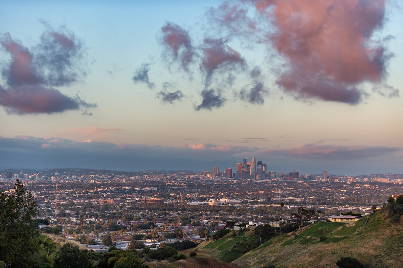 Downtown Los Angeles skyline at sunset with pink clouds