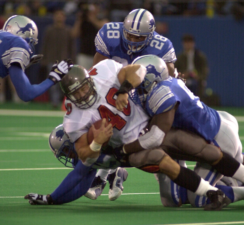 . Tampa Bay fullback Mike Alstott is swarmed by a host of Detroit Lions defenders during the Bucs victory over the Detroit Lions 20-17 at the Pontiac Silverdome Sunday.