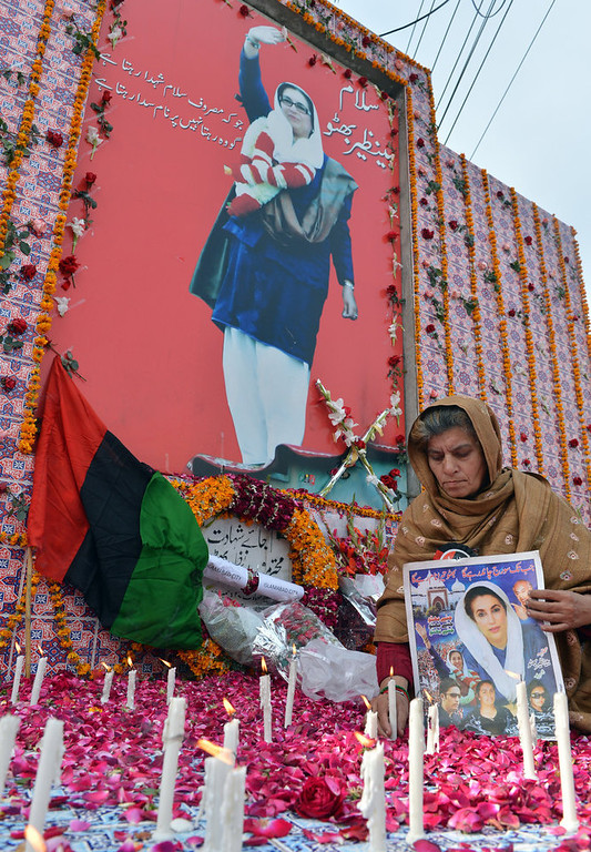 . A supporter of the ruling Pakistan Peoples Party (PPP) lights candles at the site where former premier Benazir Bhutto was assassinated, on her fifth death anniversary in Rawalpindi on December 27, 2012. The son of Pakistan\'s slain former prime minister Benazir Bhutto launched his political career Thursday on the anniversary of his mother\'s death with an attack on the country\'s judiciary. More than 200,000 people gathered at the Bhutto family mausoleum in Garhi Dera Bakhsh in the southern province of Sindh to pay their respects to Benazir and to hear Bilawal Bhutto Zardari make his first major public speech. AFP PHOTO/Aamir  QURESHI/AFP/Getty Images