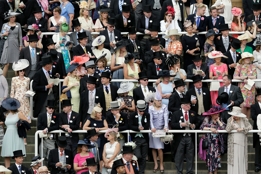 . Racegoers in the royal enclosure in the parade ring attend the second day of the Royal Ascot horse race meeting in Ascot, England, Wednesday, June 20, 2018. (AP Photo/Tim Ireland)
