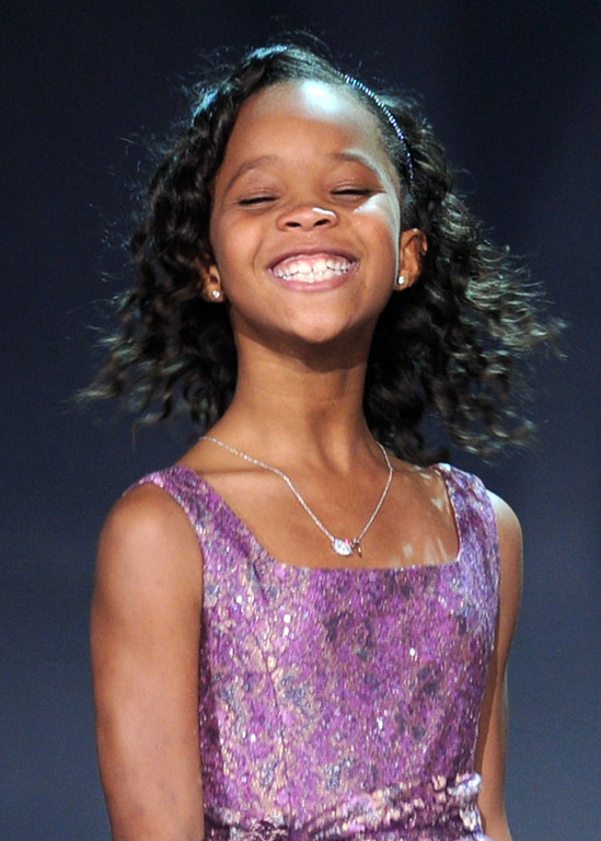 """. Actress Quvenzhane Wallis accepts the Best Young Actor/Actress Award for \""""Beasts of the Southern Wild\"""" onstage at the 18th Annual Critics\' Choice Movie Awards held at Barker Hangar on January 10, 2013 in Santa Monica, California.  (Photo by Kevin Winter/Getty Images)"""