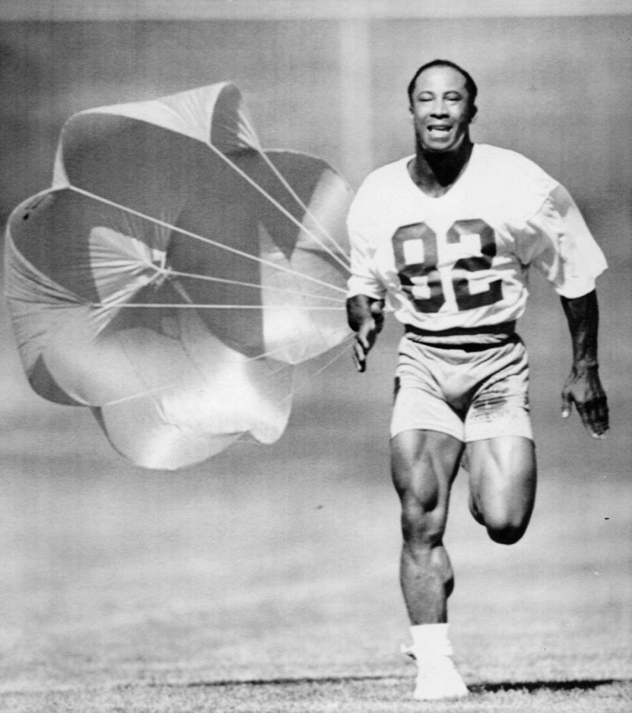 . Sept. 24, 1991: Broncos receiver Vance Johnson pulled a parachute as he ran sprints. (The Denver Post)
