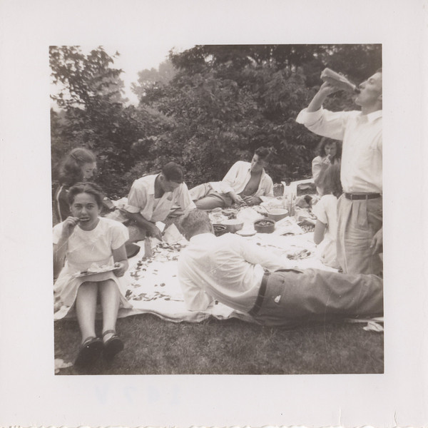 Love this... they went all out for this picnic. Mom is eating fried chicken and if I had to take a bet I would say she rung the chicken's neck, plucked the feathers, dressed it and fried it before she got to this point!!