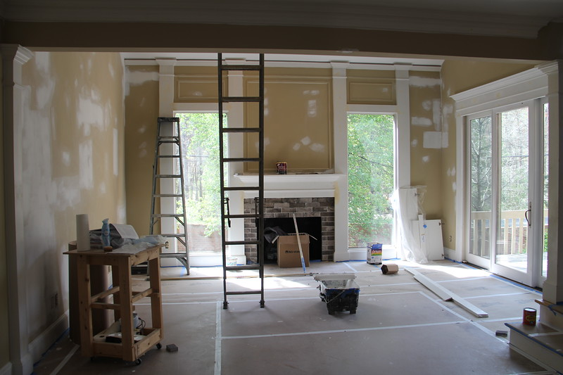 view from kitchen into main room (floors are covered so as to not damage hardwood)