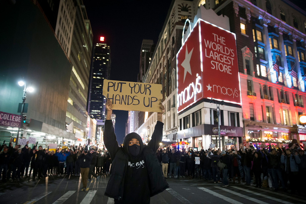 . Protestors occupy Herald Square during march Thursday, Dec. 4, 2014, in New York, against a grand jury\'s decision not to indict the police officer involved in the death of Eric Garner. A grand jury cleared a white New York City police officer Wednesday in the videotaped chokehold death of Garner, an unarmed black man, who had been stopped on suspicion of selling loose, untaxed cigarettes, a lawyer for the victim\'s family said. (AP Photo/John Minchillo)