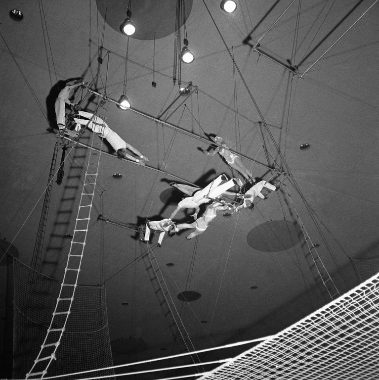 . The air is full of dizzying action as the Eight Croneras go through their sensational trapeze act at the International Circus show in Deutschland Hall in West Berlin on Jan. 22, 1958. It�s a tense moment for spectators and performers alike. (AP Photo/Heinrich Sanden)