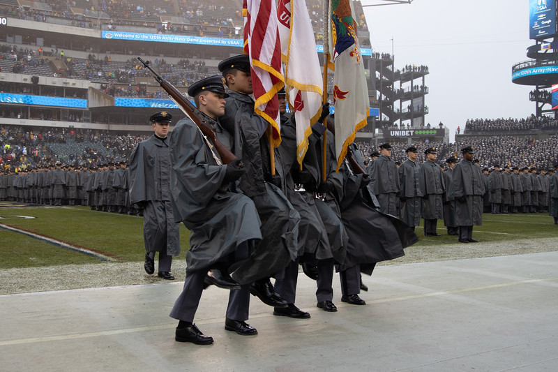 The West Point color guard marches off the field.
