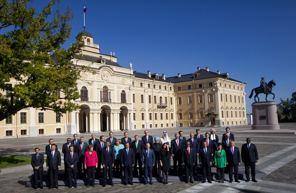 . Russia\'s President Vladimir Putin, center foreground, stands with G-20 leaders during a group photo outside of the Konstantin Palace in St. Petersburg, Russia on Friday, Sept. 6, 2013. World leaders are discussing Syria\'s civil war at the summit but look no closer to agreeing on international military intervention to stop it. (AP Photo/Pablo Martinez Monsivais)